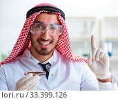 Купить «Arab chemist working in the lab office», фото № 33399126, снято 21 апреля 2018 г. (c) Elnur / Фотобанк Лори
