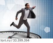 Купить «Businessman in time management concept», фото № 33399394, снято 1 апреля 2020 г. (c) Elnur / Фотобанк Лори