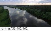 Купить «A river surface, reflecting cloudy sky», видеоролик № 33402962, снято 5 июня 2020 г. (c) Данил Руденко / Фотобанк Лори