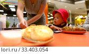 Купить «Waiter putting healthy food on table in front of child of three years old», видеоролик № 33403054, снято 10 октября 2019 г. (c) Ekaterina Demidova / Фотобанк Лори