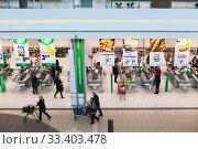 Купить «Cashdesk line is in Prisma family-friendly supermarket in the Jumbo mall, Vantaa. Хельсинки», фото № 33403478, снято 5 апреля 2018 г. (c) Кекяляйнен Андрей / Фотобанк Лори