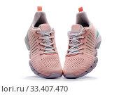 Купить «Летние женские розовые кроссовки на белом фоне», фото № 33407470, снято 9 марта 2020 г. (c) V.Ivantsov / Фотобанк Лори