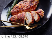 Купить «Skinless boneless chicken breasts on a black plate», фото № 33408570, снято 12 февраля 2020 г. (c) Oksana Zh / Фотобанк Лори