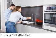 Купить «Couple engaged in household chores», фото № 33408626, снято 24 мая 2018 г. (c) Яков Филимонов / Фотобанк Лори