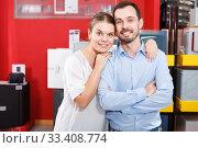 Купить «Young loving couple standing in specialty workshop of safes», фото № 33408774, снято 17 апреля 2018 г. (c) Яков Филимонов / Фотобанк Лори