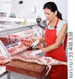 Adult woman seller carving of pig carcass. Стоковое фото, фотограф Яков Филимонов / Фотобанк Лори