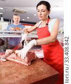 Girl seller cutting meat at the request customer. Стоковое фото, фотограф Яков Филимонов / Фотобанк Лори