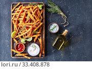 crispy salty Sweet Potato Fries on a board. Стоковое фото, фотограф Oksana Zh / Фотобанк Лори
