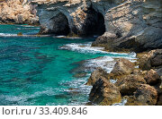 Купить «The caves of the elevated rocky shore of Cape Greco. Cyprus», фото № 33409846, снято 18 июня 2018 г. (c) Serg Zastavkin / Фотобанк Лори
