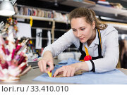 Smiling woman tailor working with marker for modeling clothes. Стоковое фото, фотограф Яков Филимонов / Фотобанк Лори