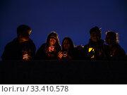 """Купить «Ежегодная экологическая акция Всемирного фонда дикой природы (WWF) """"Час Земли"""". Участники акции с зажженными свечами.», фото № 33410578, снято 30 марта 2019 г. (c) Евгений Кашпирев / Фотобанк Лори"""