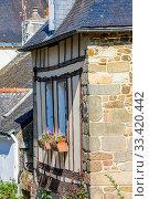 Купить «Closeup on exterior facade and slate roof of a typical brittany house», фото № 33420442, снято 8 апреля 2020 г. (c) easy Fotostock / Фотобанк Лори
