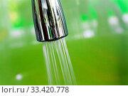 Купить «Closeup on modern stainless steel faucet knob with flowing water», фото № 33420778, снято 4 июля 2020 г. (c) easy Fotostock / Фотобанк Лори