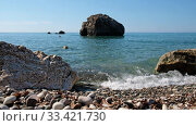 Купить «Petra tou Romiou or Aphrodite Rock Beach, one of the main attractions and landmarks of Cyprus island.», видеоролик № 33421730, снято 17 марта 2020 г. (c) Serg Zastavkin / Фотобанк Лори