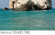 Купить «Aphrodite's Stone on Petra tou Romiou or Aphrodite Rock Beach, one of the main attractions and landmarks of Cyprus island.», видеоролик № 33421742, снято 19 марта 2020 г. (c) Serg Zastavkin / Фотобанк Лори