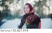Russian folklore - russian woman in a scarf is clapping her hands and smiling. Стоковое фото, фотограф Константин Шишкин / Фотобанк Лори