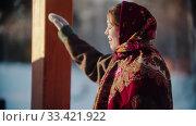 Russian folklore - Russian woman smiling standing outdoors. Стоковое фото, фотограф Константин Шишкин / Фотобанк Лори