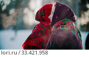 Russian folklore - a woman in a bright shawl standing outdoors in the winter forest. Стоковое фото, фотограф Константин Шишкин / Фотобанк Лори