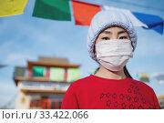 Купить «asian portrait wearing mask temple public place», фото № 33422066, снято 23 марта 2020 г. (c) Mark Agnor / Фотобанк Лори