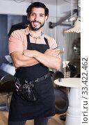 Positive sexy worker man hairdresser standing. Стоковое фото, фотограф Яков Филимонов / Фотобанк Лори