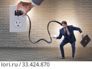 Купить «Businessman being powered by electricity and plug», фото № 33424870, снято 4 апреля 2020 г. (c) Elnur / Фотобанк Лори