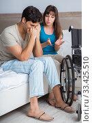 Купить «Desperate man on wheelchair with his sad wife», фото № 33425510, снято 9 августа 2017 г. (c) Elnur / Фотобанк Лори