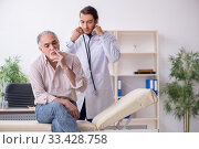 Купить «Young male doctor and old patient in antismoking concept», фото № 33428758, снято 9 сентября 2019 г. (c) Elnur / Фотобанк Лори