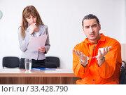 Купить «Young man meeting with advocate in pre-trial detention», фото № 33428790, снято 20 мая 2019 г. (c) Elnur / Фотобанк Лори