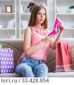 Купить «Young woman with shopping bags indoors home on sofa», фото № 33428854, снято 19 июня 2017 г. (c) Elnur / Фотобанк Лори