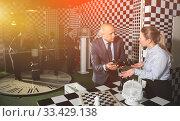 Купить «Group of colleagues solving puzzle», фото № 33429138, снято 29 января 2019 г. (c) Яков Филимонов / Фотобанк Лори