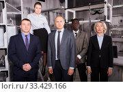 Купить «Confident businesspeople in escape room-lab», фото № 33429166, снято 29 января 2019 г. (c) Яков Филимонов / Фотобанк Лори