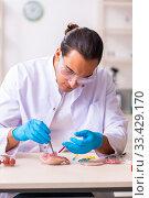Купить «Young male nutrition expert testing food products in lab», фото № 33429170, снято 3 сентября 2019 г. (c) Elnur / Фотобанк Лори