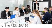Купить «female making presentation», фото № 33429190, снято 10 марта 2018 г. (c) Яков Филимонов / Фотобанк Лори
