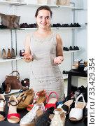 female seller in shoes store. Стоковое фото, фотограф Яков Филимонов / Фотобанк Лори
