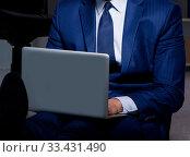 Купить «Businessman working overtime long hours late in office», фото № 33431490, снято 9 октября 2017 г. (c) Elnur / Фотобанк Лори