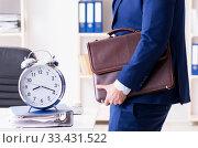 Купить «Businessman in rush trying to meet deadline», фото № 33431522, снято 2 декабря 2017 г. (c) Elnur / Фотобанк Лори