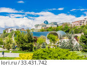A view of the President Palace and Rike Concert hall behind the Rike park on the Mtkvari Kura river bank in the downtown Tbilisi. Редакционное фото, фотограф Николай Коржов / Фотобанк Лори