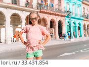Купить «Tourist girls in popular area in Havana, Cuba. Young woman traveler smiling», фото № 33431854, снято 12 апреля 2017 г. (c) Дмитрий Травников / Фотобанк Лори