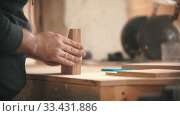 Купить «Carpentry working - man holding flat pieces of wooden details», видеоролик № 33431886, снято 2 апреля 2020 г. (c) Константин Шишкин / Фотобанк Лори