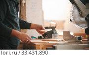 Купить «Carpentry working - bearded man making marks on the plywood», видеоролик № 33431890, снято 2 июня 2020 г. (c) Константин Шишкин / Фотобанк Лори