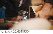 Купить «Carpentry working - man worker drilling the holes in plywood piece», видеоролик № 33431930, снято 2 июня 2020 г. (c) Константин Шишкин / Фотобанк Лори