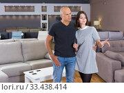 Couple choosing sofa in furniture store. Стоковое фото, фотограф Яков Филимонов / Фотобанк Лори