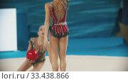 Купить «RUSSIA, KAZAN 12-03-2020, Kazan Stars Open: Young women showing their performance at the rhythmic gymnastics tournament using balls», видеоролик № 33438866, снято 27 мая 2020 г. (c) Константин Шишкин / Фотобанк Лори