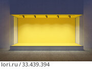 Купить «Empty showcase of a shop in the evening light», иллюстрация № 33439394 (c) Дмитрий Кутлаев / Фотобанк Лори