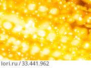 Купить «Golden Christmas lights, New Years Eve fireworks and abstract texture concept - Glamorous gold shiny glow and glitter, luxury holiday background», фото № 33441962, снято 14 июля 2020 г. (c) easy Fotostock / Фотобанк Лори