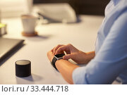 woman with smart watch and speaker at night office. Стоковое фото, фотограф Syda Productions / Фотобанк Лори