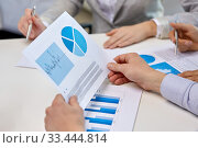 business team hands with pens and charts at office. Стоковое фото, фотограф Syda Productions / Фотобанк Лори