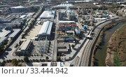 Купить «View of chemical factory complex near city», видеоролик № 33444942, снято 5 марта 2019 г. (c) Яков Филимонов / Фотобанк Лори
