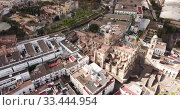 Купить «Aerial panoramic view of Jerez de la Frontera cityscape with Cathedral of Holy Saviour and Moorish alcazar, Spain», видеоролик № 33444954, снято 19 апреля 2019 г. (c) Яков Филимонов / Фотобанк Лори