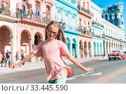 Купить «Tourist girls in popular area in Havana, Cuba. Young woman traveler smiling», фото № 33445590, снято 12 апреля 2017 г. (c) Дмитрий Травников / Фотобанк Лори